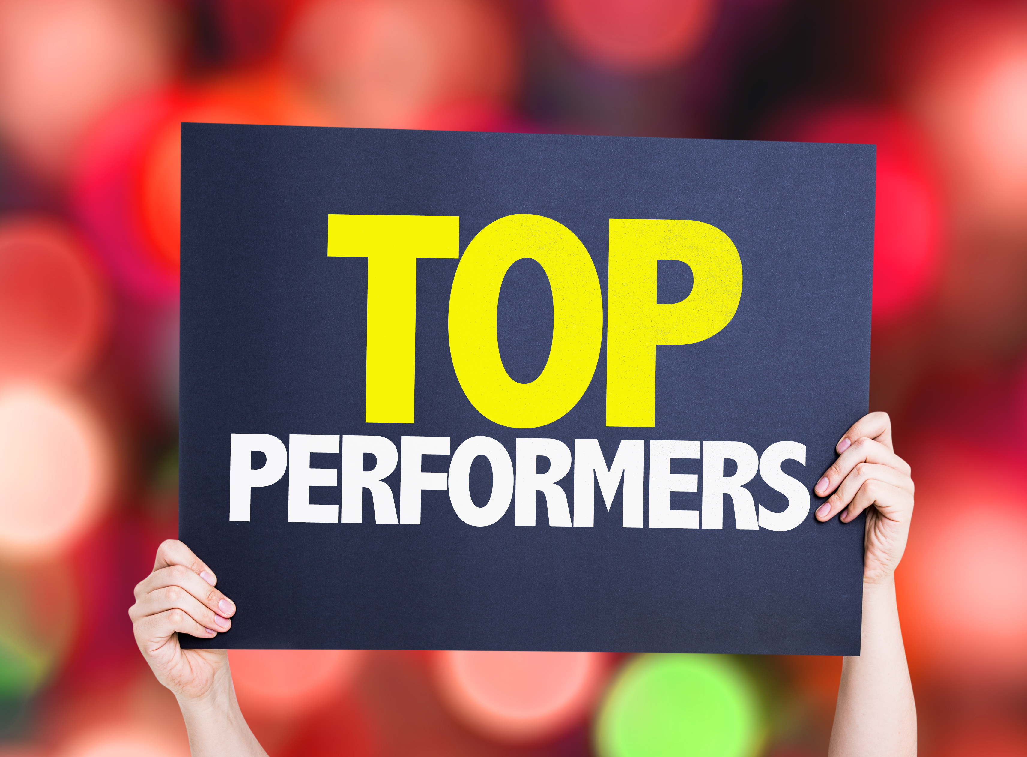Top Performers placard with bokeh background